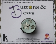 Ring, Light Blue with Silver Flowers & Brown Button, Sizeable